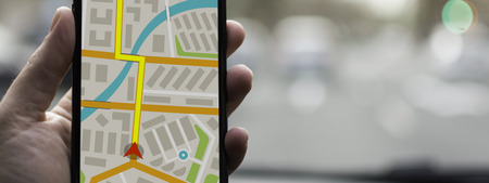 Photo pour GPS Navigation on Mobile Phone Device and Transportation Concept. Male Hand Using Navigation System Map Tracking on Smartphone with Copy Space. - image libre de droit