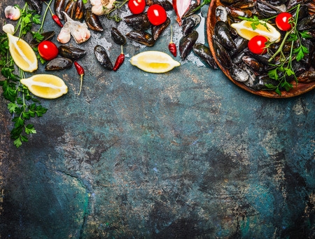 Fresh mussels with ingredients for cooking on rustic background