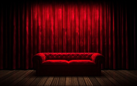 Foto de red curtain stage with sofa - Imagen libre de derechos