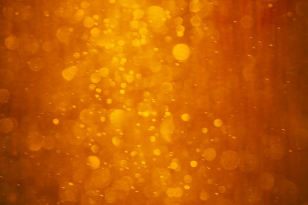 Photo pour Orange - red - yellow background. It is photo of snow fall in night in lantern light. This blurred snowing in warm colors can be a Christmas or winter background texture. - image libre de droit