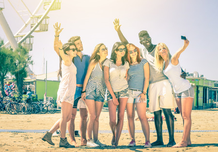 Photo for Group of multiracial happy friends taking a selfie at ferris wheel - International concept of happiness and multi ethnic friendship all together against racism for peace and fun - Vintage filtered look - Royalty Free Image