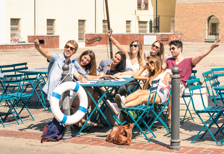 Photo for Group of happy best friends taking a selfie - Tourists having fun in the summer around the old town - University students during a break in a sunny day - Royalty Free Image