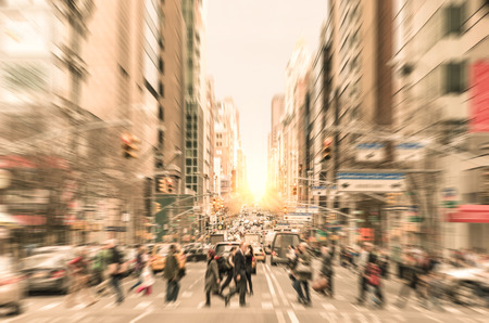 Foto de People on the street on Madison Avenue in Manhattan downtown before sunset in New York city - Commuters walking on zebra crossing during rush hour in american business district - Imagen libre de derechos