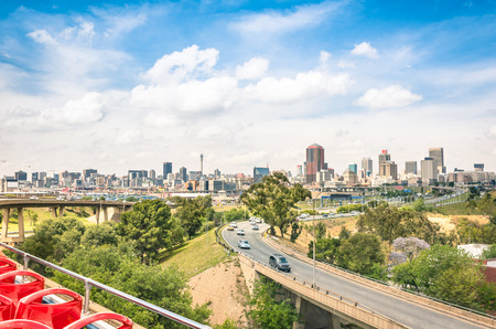 Photo for Wide angle view of Johannesburg skyline from the highways during a sightseeing tour around the urban area - Metropolitan buildings of the business district in the capital of South Africa - Royalty Free Image