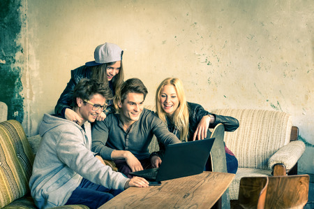 Photo for Group of young hipster best friends with computer laptop in urban alternative location - Concept of friendship and fun with new trends and technology - Wireless connection and web internet interaction - Royalty Free Image