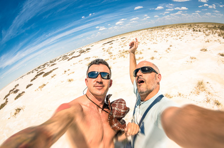 Photo pour Hipster best  friends taking a selfie at Etosha national park in Namibia - Adventure travel lifestyle enjoying moment and sharing happiness - Trip together around the world as alternative lifestyle - image libre de droit