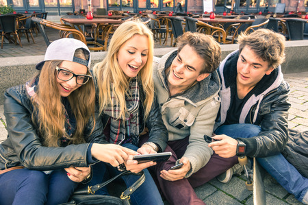 Photo for Group of young hipster friends having fun together with smartphone - Modern situation of technology interaction in everyday lifestyle - Internet wifi connection spots outdoors - Royalty Free Image