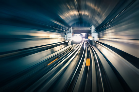 Photo pour Subway tunnel with blurred light tracks with arriving train in the opposite direction - Concept of modern metro underground transport and connection speed - image libre de droit
