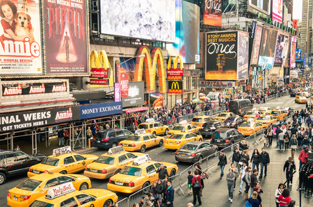 Foto de NEW YORK - DECEMBER 22, 2014: taxicabs and traffic jam congestion in front of Mc Donalds in Times Square in Manhattan, New York. Times Square is one of the world - Imagen libre de derechos
