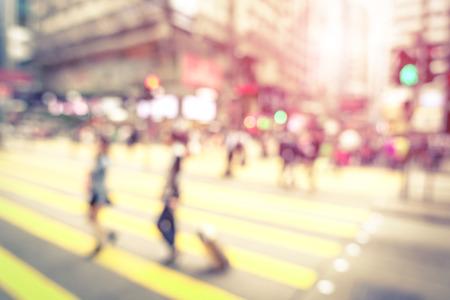 Foto de Blurred defocused abstract background of people walking on zebra crossing with vintage marsala filter  - Imagen libre de derechos
