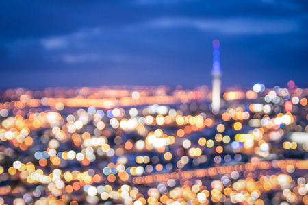 Photo for Bokeh of Auckland skyline from Mount Eden after sunset during the blue hour - New Zealand modern city with spectacular nightscape panorama - Blurred defocused night lights - Royalty Free Image