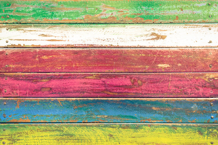 Photo for Multicolored wood background and alternative construction material - Texture on wooden table in alterative fashion restaurant - Retro seamless backdrop pattern - Soft vintage desaturated filtered look - Royalty Free Image