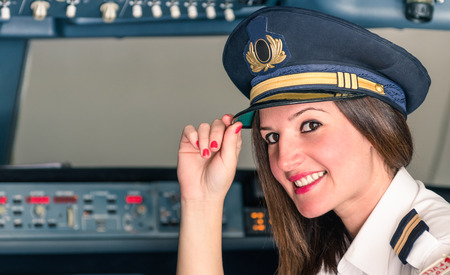 Photo pour Young female Pilot ready for Takeoff - image libre de droit