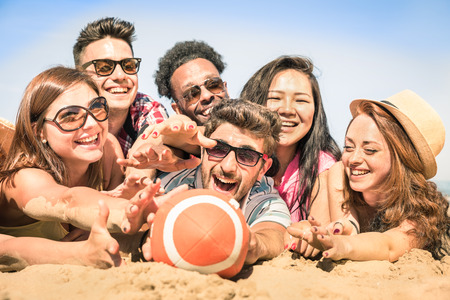 Photo for Group of multiracial happy friends having fun at beach games - Royalty Free Image
