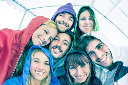 Photo for Best friends taking selfie wearing hoodies outdoors - Happy friendship concept with young people looking at camera having fun together - Cold cyan filtered look with focus in the middle of the frame - Royalty Free Image