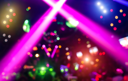 Photo pour Abstract background with defocused bokeh of laser show in modern disco party night club - Concept of nightlife with music and entertainment - Image with powered colored halos and vivid bright lights - image libre de droit