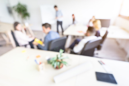 Foto de Blurred defocused background of businesspeople meeting with concentrated start up entrepreneur coworkers - Business concept with young people team in modern minimal office - Bright  desaturated filter - Imagen libre de derechos