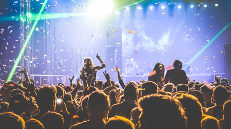 Photo for Young people dancing at night club - Hands up and multicolored confetti at nightclub after party - Nightlife concept with afterparty crowd celebrating dj concert festival event - Retro contrast filter - Royalty Free Image