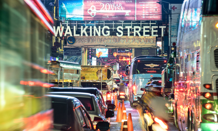 Foto de PATTAYA, THAILAND - FEBRUARY 18, 2016: beginning of famous Walking Street by night -The street runs from the south end of Beach Road to the Bali Hai Pier and is closed to the traffic after 6pm - Imagen libre de derechos