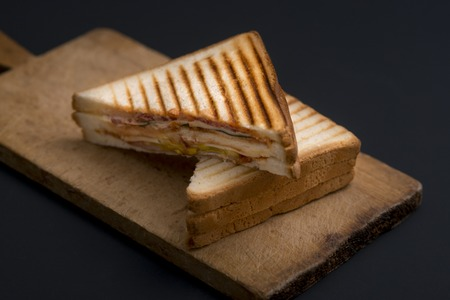 Photo for club sandwich on a wooden board on a dark background - Royalty Free Image