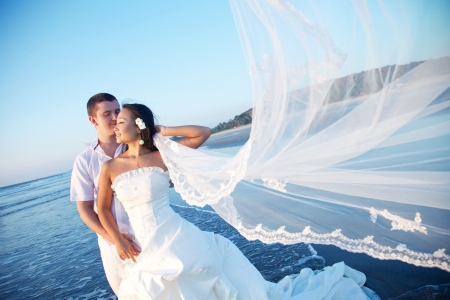 Photo for Honeymoon couple on the beach - Royalty Free Image