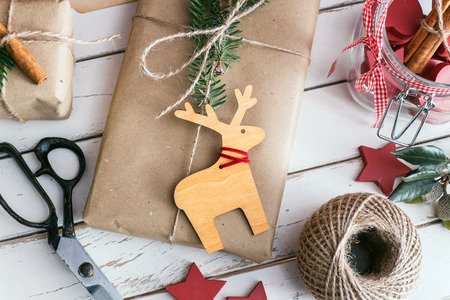 Photo pour Homemade wrapped christmas presents with tools and decorations - image libre de droit