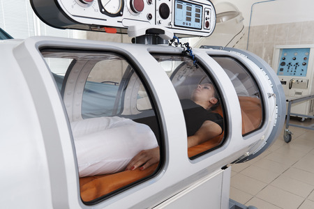 Foto de A pressure chamber is a device that saturates the body with a significant amount of oxygen. Hyperbaric oxygenation. - Imagen libre de derechos