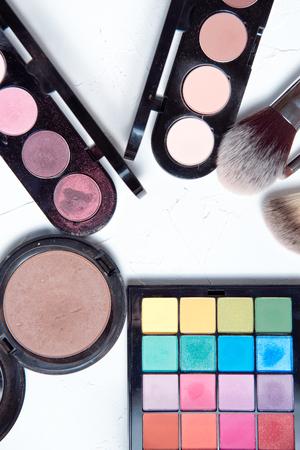 Foto de Professional makeup tools on white wooden background. - Imagen libre de derechos