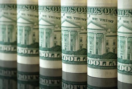 Foto de Many US dollars in the form of tubes - Imagen libre de derechos