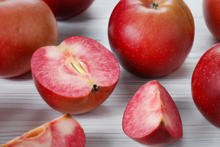 Photo pour Red apples called Redlove are located on a wooden surface - image libre de droit
