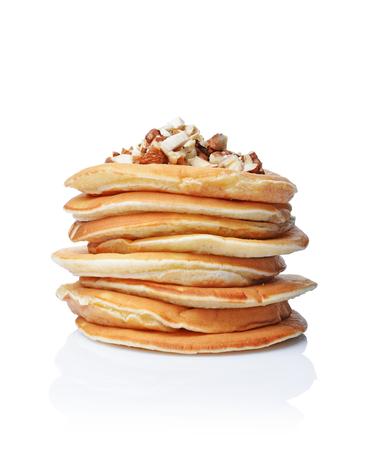 Photo for Tasty breakfast. Homemade pancakes with crushed hazelnut isolated on white background - Royalty Free Image