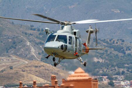 Foto de MOTRIL, GRANADA, SPAIN-JUN 17: Helicopter Sikorsky S-76C taking part in an exhibition on the 13th international airshow of Motril on Jun 17, 2018, in Motril, Granada, Spain - Imagen libre de derechos