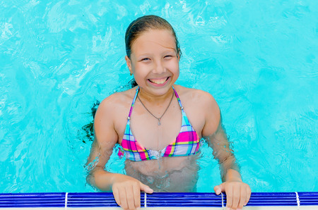 Foto de Active Little happy girl in swimming pool in aquapark, , summer holidays, joy and pleasure concept - Imagen libre de derechos