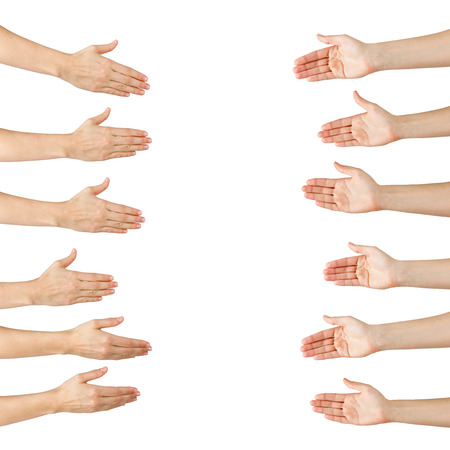Foto de Various female hands offering handshake isolated on white background, copy space, clipping pass. Closeup picture of woman shaking hands - Imagen libre de derechos