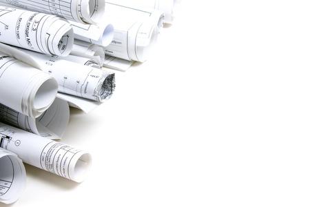 Photo pour Architectural blueprints and blueprint rolls on white background - image libre de droit