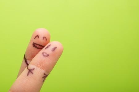 Foto de Funny finger holding blank bunner and smiling. - Imagen libre de derechos