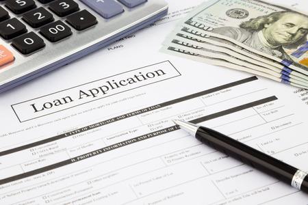 Photo pour closeup loan application form and dollar banknotes, business and finance concept and idea - image libre de droit