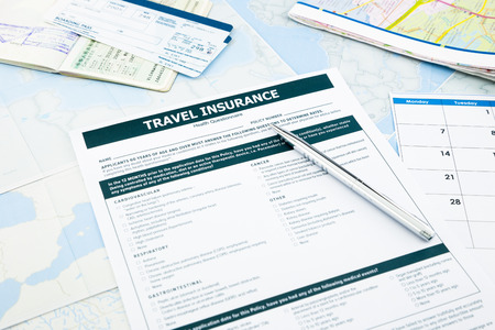 travel insurance form, passport and tickets on world map paperwork, concept and idea for insurance business