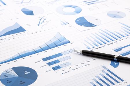 Foto de pen on blue charts, graphs, data and reports background for education and business concepts - Imagen libre de derechos
