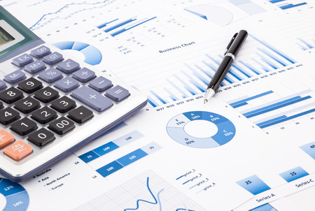Photo for calculator and pen with blue business charts, graphs, infomation and reports background for financial and business concepts - Royalty Free Image
