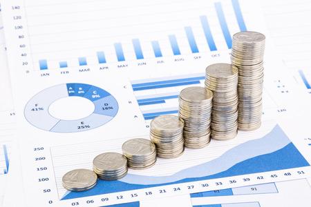 Photo pour closeup stacks of  Thai baht coins on blue graphs and charts background, money and financial concepts - image libre de droit