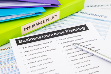 Photo pour Business insurance planning checklist with documents and binders, concept for risk management - image libre de droit