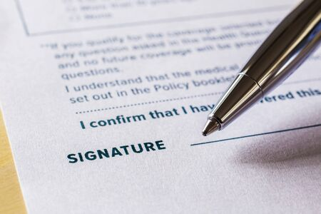 Photo pour Close up word signature with pen on legal contract form. Policy document, registration, employment and business startup concept. - image libre de droit