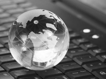 Globe on keyboard isolated on white