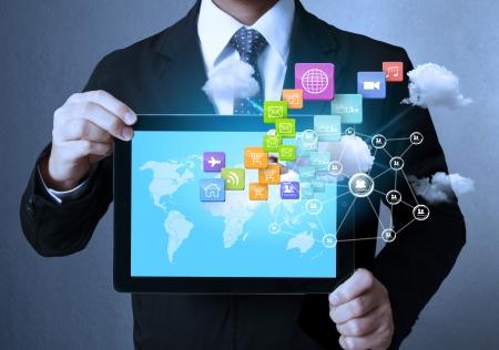 Foto de touch- tablet in hands Business man  - Imagen libre de derechos