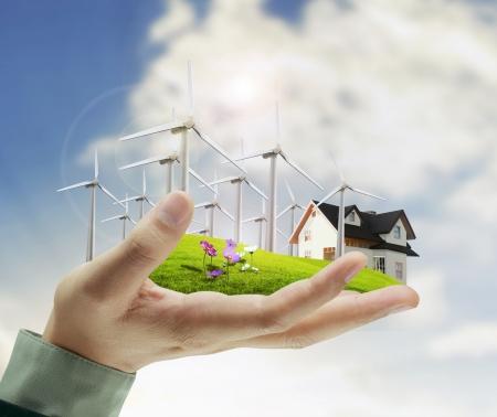 Photo pour wind turbine in hand businessman - image libre de droit