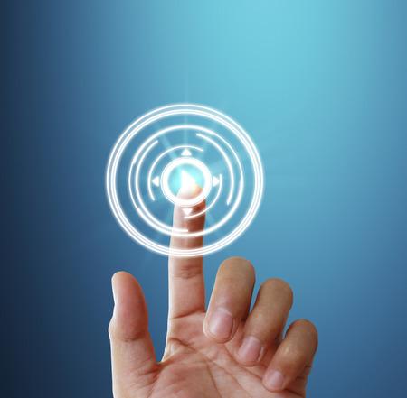 Photo pour Finger pressing the touch screen display - image libre de droit