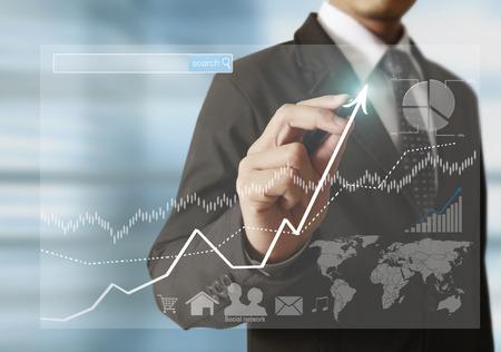 Photo pour businessman hand writing a business graph - image libre de droit