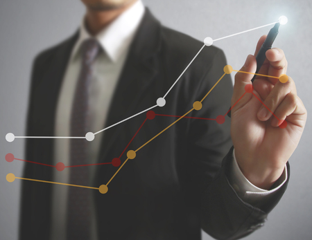Foto für Businessman drawing graphics a growing graph - Lizenzfreies Bild