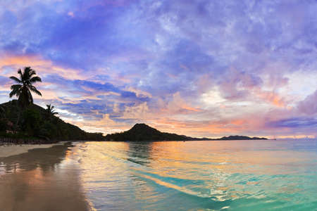 Photo for Tropical beach Cote d'Or at sunset, Seychelles - vacation background  - Royalty Free Image